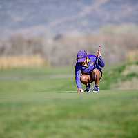 Kirtland Central Bronco Tiger Lily Tsosie places her golf ball before a put attempt at the Grants Golf tournament  at the Coyote Del Malpais in Grants Tuesday.