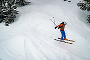 Skiers and riders take in the snow and chairlift on a March day at Monarch Mountain.