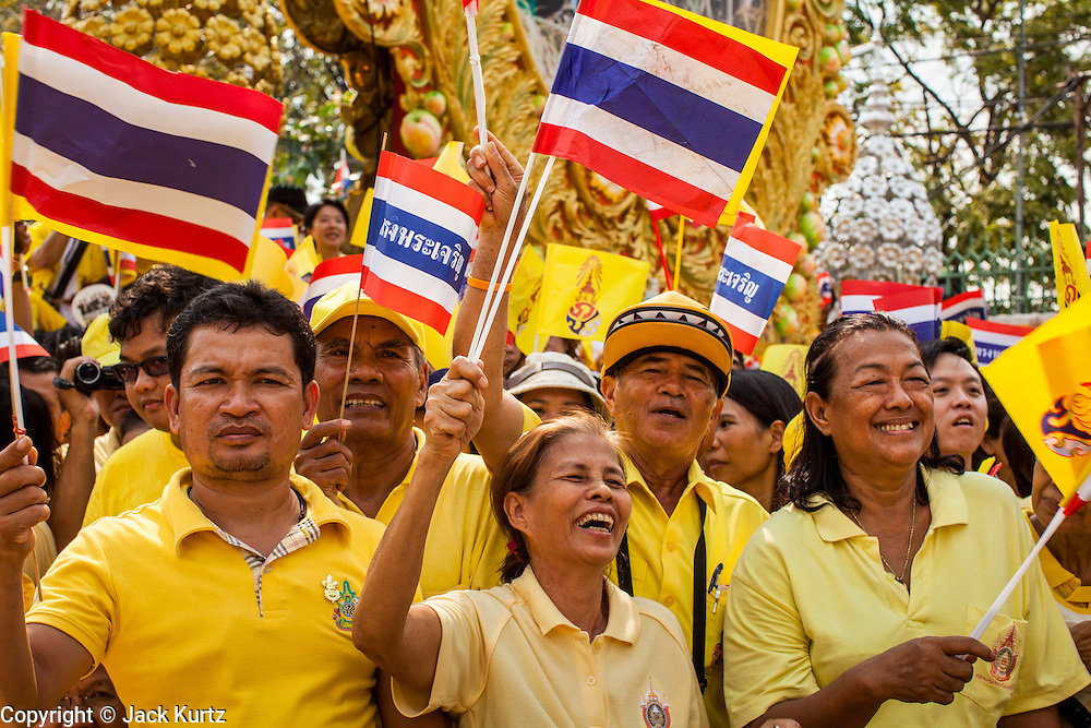 05 DECEMBER 2012 - BANGKOK, THAILAND: People wave flags while they gather on the Royal Plaza Wednesday to see Bhumibol Adulyadej, the King of Thailand, before his public audience at the Mukkhadej balcony of the Ananta Samakhom Throne Hall. December 5 is a national holiday. It's also celebrated as Father's Day. Celebrations are being held across the country to mark the birthday of Bhumibol Adulyadej, the King of Thailand.     PHOTO BY JACK KURTZ