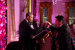 President Barack Obama and Prime Minister Shinzo Abe of Japan participate in a toast with sake during the State Dinner in the East Room of the White House, April 28, 2015. (Official White House Photo by Pete Souza)<br /> <br /> This official White House photograph is being made available only for publication by news organizations and/or for personal use printing by the subject(s) of the photograph. The photograph may not be manipulated in any way and may not be used in commercial or political materials, advertisements, emails, products, promotions that in any way suggests approval or endorsement of the President, the First Family, or the White House.
