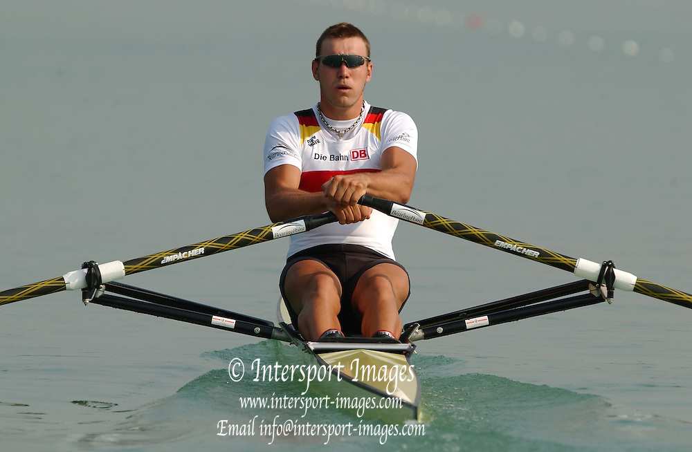 28/08/2003 Thursday.2003 World Rowing Championships, Idroscala. Milan, Italy.Semi finals, men's single sculls, Germany's Marcel Hacker, at the start of his semi final ... Milan. ITALY 2003 World Rowing Championships. Idro Scala Rowing Course. [Mandatory Credit: Peter Spurrier: Intersport Images.]