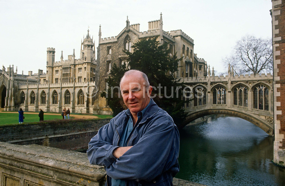 A portrait of Australian-born, Clive James on 20th January 1990 in Cambridge UK. Clive James AO CBE FRSL b1939 is an Australian author, critic, broadcaster, poet, translator and memoirist, best known for his autobiographical series Unreliable Memoirs, for his chat shows and documentaries on British television and for his prolific journalism. He has lived and worked in the United Kingdom since 1962.