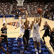 Gabby Williams, (right), UConn, drives to the basket challenged by Marey Hill, Cincinnati during the UConn Vs Cincinnati Quarterfinal Basketball game at the American Women's College Basketball Championships 2015 at Mohegan Sun Arena, Uncasville, Connecticut, USA. 7th March 2015. Photo Tim Clayton