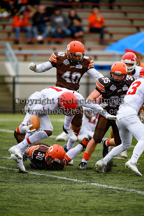 CHILLIWACK, BC - SEPTEMBER 11: Tristan Peddle #30 tackles Dolani Robinson #1 of Westshore Rebels at Exhibition Stadium in Chilliwack, BC, Canada. (Photo by Marissa Baecker/Shoot the Breeze)