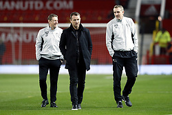 Derby County coach Kevin Poole (left) and first team coach Mark Sale (right) with manager Gary Rowett (centre) prior to the FA Cup, third round match at Old Trafford, Manchester.