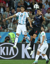 NIZHNY NOVGOROD, June 21, 2018  Maximiliano Meza (L) of Argentina competes for a header with Dejan Lovren (C) of Croatia during the 2018 FIFA World Cup Group D match between Argentina and Croatia in Nizhny Novgorod, Russia, June 21, 2018. (Credit Image: © Wu Zhuang/Xinhua via ZUMA Wire)