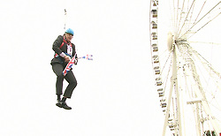 File photo dated 01/08/12 of Boris Johnson stuck on a zip wire while promoting London for the Olympic Games during his tenure as the Mayor of London. Mr Johnson has been elected by Conservative party members as the new party leader, and will become the next Prime Minister of the United Kingdom.