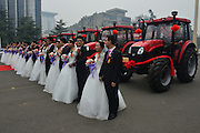LUOYANG, CHINA - OCTOBER 10: (CHINA OUT) <br /> <br /> Wedding On Tractors For 19 Couples<br /> <br /> 19 couples hold wedding together with tractors as their wedding car on October 10, 2014 in Luoyang, Henan province of China. Wedding on tractors for 19 couples was held by YTO Group Corporation on Friday in Luoyang.<br /> ©Exclusivepix