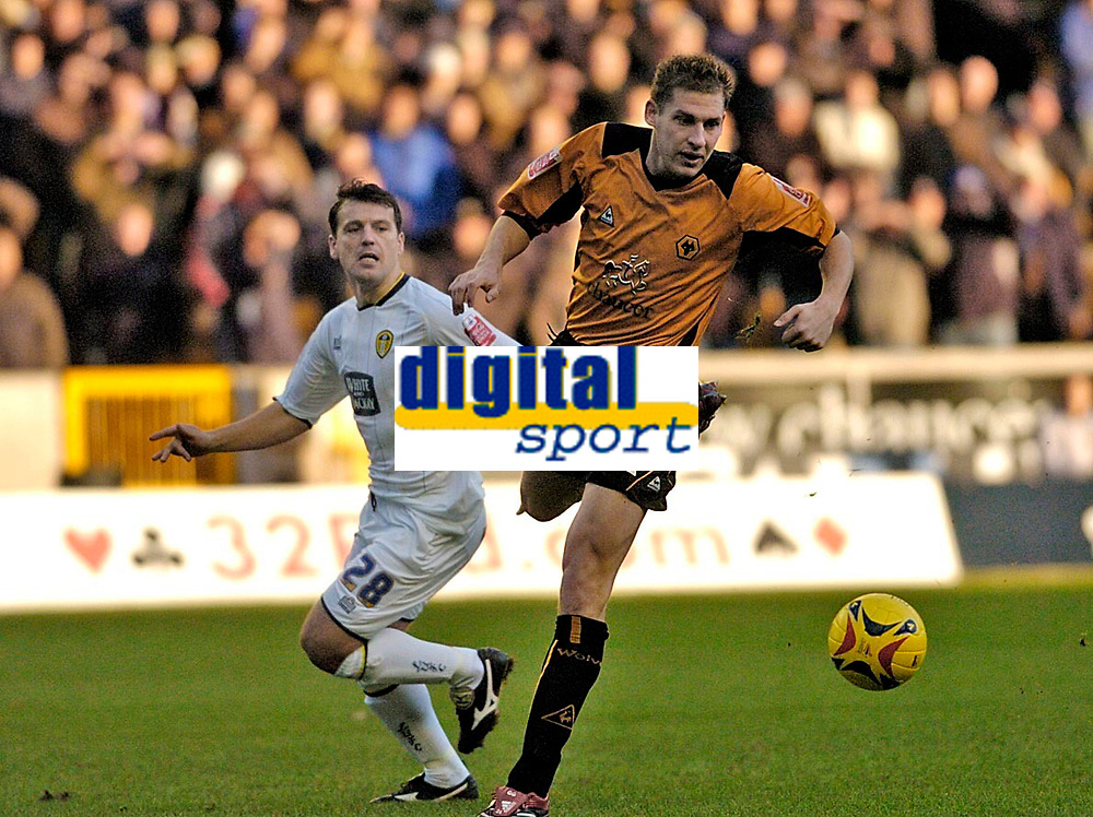 Photo: Leigh Quinnell.<br /> Wolverhampton Wanderers v Leeds United. Coca Cola Championship. 17/12/2005. Wolves' Gabor Gyepes gets to the ball before Leeds' Robbie Blake.