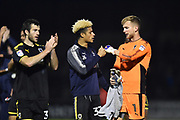 Lyle Taylor (33) of AFC Wimbledon and George Long (1) of AFC Wimbledon touch fists in celebration at full time after AFC Wimbledon beat Bristol Rovers 3-1 during the EFL Sky Bet League 1 match between Bristol Rovers and AFC Wimbledon at the Memorial Stadium, Bristol, England on 18 November 2017. Photo by Graham Hunt.