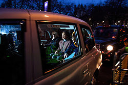 © Licensed to London News Pictures. 07/12/2016. London, UK. GINA MILLER (centre) in a taxi as she leaves the Supreme Court in Westminster, London following day three of a hearing to appeal against a November 3 High Court ruling that Article 50 cannot be triggered without a vote in Parliament. Photo credit: Ben Cawthra/LNP