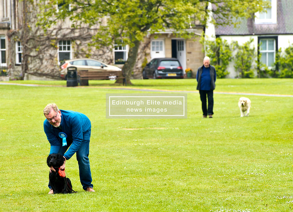 Pictured: David Mundell and Wilson, Ruth Davidson's dog.<br /> <br /> Scottish Tory leader Ruth Davidson and Scottish Secretary David Mundell took to the campaign trail in West Linton today.<br /> <br /> Ger Harley | EEm 13 May 2017