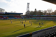 Rochdale players build an attack with the sun in their eyes during the EFL Sky Bet League 1 match between Rochdale and Burton Albion at the Crown Oil Arena, Rochdale, England on 27 February 2021.