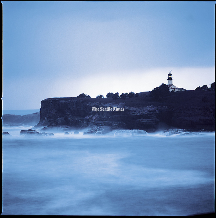 Cape Flattery Lighthouse pierces the gloom as another winter storm barrels in from the Pacific. (Benjamin Benschneider / The Seattle Times)