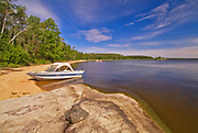 Boat on sandy beach of an island in Lake of the Woods<br />