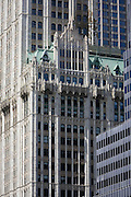 Modern architecture surrounds the 1903 Gothic Woolworth building on the left, in Manhattan, New York City.