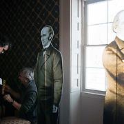 Plexiglass stand-ins for Lincoln's Cabinet are prepared.