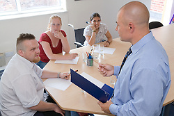 Office workers in a board room meeting,