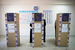 © Licensed to London News Pictures. 30/04/2014. Sulaimaniya, Iraq. Iraqi-Kurdish people cast their votes behind cardboard booths located in a school during the 2014 Iraqi parliamentary elections in Sulaimaniya, Iraqi-Kurdistan today (30/04/2014). <br /> <br /> The period leading up to the elections, the fourth held since the 2003 coalition forces invasion, has already seen polling stations in central Iraq hit by suicide bombers causing at least 27 deaths. Photo credit: Matt Cetti-Roberts/LNP