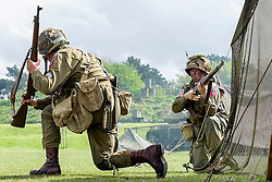 Members of the US 82nd Airborne/505th RCT living History Group take part in the first days battle re-enactment at Fort Paull <br /> <br />   03 May 2015<br />   Image © Paul David Drabble <br />   www.pauldaviddrabble.co.uk