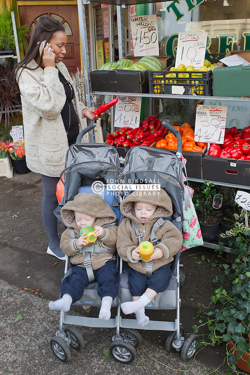 Mother with twins in buggy out shopping. (This photo has extra clearance covering Homelessness, Mental Health Issues, Bullying, Education and Exclusion, as well as the usual clearance for Fostering & Adoption and general Social Services contexts,)