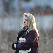 A women looks on near the fire station in Sandy Hook after today's shootings at Sandy Hook Elementary School, Newtown, Connecticut, USA. 14th December 2012. Photo Tim Clayton