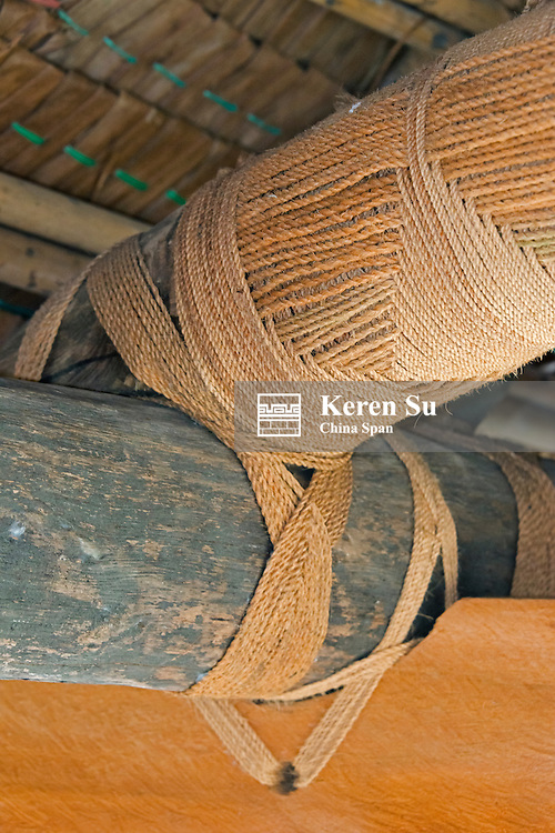 Using ropes to tighten joints in traditional house, Yap Island, Federated States of Micronesia