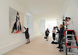 """© under license to London News Pictures. LONDON, UK  05/05/2011. Members of the press photograph the tapestry 'The Black Cat' by Tracy Emin which took seven years to complete.  The unveiling today (5 May 2011) of Tracey Emin's first tapestry ahead of the launch of COLLECT, the Crafts Council's international craft fair for contemporary objects at the Saatchi Gallery, London. Tracy Emin say's: """"The Black Cat is one of my favourite paintings. It took me seven years to complete...""""Photo credit should read Stephen Simpson/LNP."""