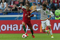 (170619) -- KAZAN, June 19, 2017 -- Portugal s Cristiano Ronaldo (L) vies with Mexico s Diego Reyes during the 2017 Confederations Cup Group A football match in Kazan, Russia, on June 18, 2017. ) (SP)RUSSIA-KAZAN-2017 FIFA CONFEDERATIONS CUP <br /> <br /> Norway only