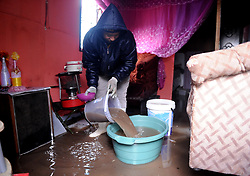 South Africa - Cape Town - 10 July 2020 - Lwandiso Ntebe trying to take water out of his home in Burundi in Mfuleni, about 520 houses in Burundi Informal Settlement are flooded. Photographer Ayanda Ndamane African news agency (ANA)