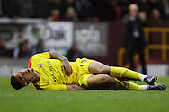 Jonson Clarke-Harris of Rotherham United lies in pain after he falls awkwardly and injures himself. Skybet football league Championship match, Burnley v Rotherham United at Turf Moor in Burnley, Lancs on Saturday 20th February 2016.<br /> pic by Chris Stading, Andrew Orchard sports photography.