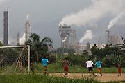 Football game at Jardim São Marcos favela, Cubatão adjacent to the Fosfertil fertiliser factory