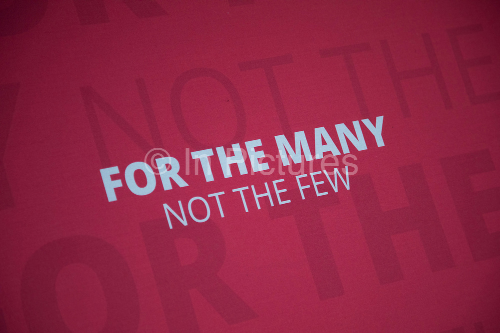 Labour Party slogan For The Many Not The Few at a press conference podium in London, England, United Kingdom. These words became synonymous with the Labour general election campaign of 2017.