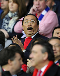 Cardiff City owner, Vincent Tan yawns - Photo mandatory by-line: Joe Meredith/JMP - Tel: Mobile: 07966 386802 03/11/2013 - SPORT - FOOTBALL - The Cardiff City Stadium - Cardiff - Cardiff City v Swansea City - Barclays Premier League