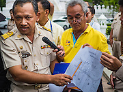 15 AUGUST 2016 - BANGKOK, THAILAND:  A Bangkok city officials briefs city workers on the process for serving eviction notices to the residents of the Pom Mahakan slum. Final eviction notices were posted today and residents of the slum have been told they must leave the fort by September 3, 2016. The Pom Mahakan community is known for fireworks, fighting cocks and bird cages. Mahakan Fort was built in 1783 during the reign of Siamese King Rama I. It was one of 14 fortresses designed to protect Bangkok from foreign invaders. Only two of the forts are still standing, the others have been torn down. A community developed in the fort when people started building houses and moving into it during the reign of King Rama V (1868-1910). The land was expropriated by Bangkok city government in 1992, but the people living in the fort refused to move. In 2004 courts ruled against the residents and said the city could take the land.      PHOTO BY JACK KURTZ