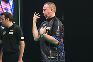 Glen Durrant reaction after missing a dart at a double during the Unibet Premier League Play-Offs at the Ricoh Arena, Coventry, England on 15 October 2020.