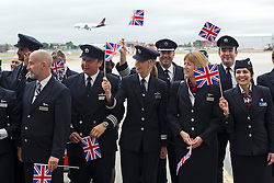© London News Pictures. 04/07/2013 . London, UK.  British Airways staff  wave union flags as they welcome the new British Airways AIRBUS A380 superjumbo which arrived at Heathrow Airport on July 4, 2013. It was the first time British Airlines have taken delivery of the new plane, making British Airways the first European airline to operate both the 787 and A380. Photo credit : Ben Cawthra/