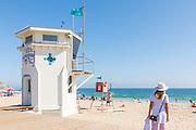 Lady Standing Looking at the Ocean at Laguna Beach Main Beach