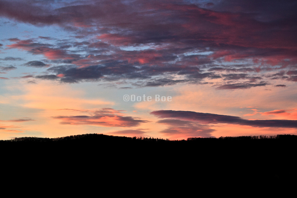 orange wind swept clouds at sunrise