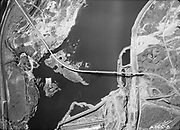 """9305-A4630-8. """"Aerial. Atkinson Ostrander (construction company). Aerial Map (of The Dalles Dam construction site). First run. Mar 7, 1955"""" Excellent aerial view of Lone Pine."""