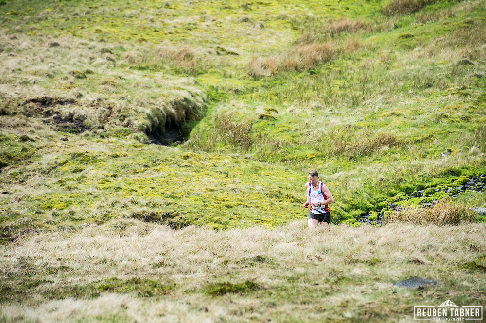 A runner takes a short cut down Ingleborough in the Yorkshire Dales during the 60th Yorkshire Three Peaks Race.