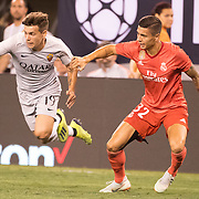 MEADOWLANDS, NEW JERSEY- August 7:  Ante Coric #19 of AS Roma challenged by Javi Sánchez #32 of Real Madrid in action during the Real Madrid vs AS Roma International Champions Cup match at MetLife Stadium on August 7, 2018 in Meadowlands, New Jersey. (Photo by Tim Clayton/Corbis via Getty Images)