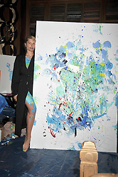 MEREDITH OSTROM in front of a painting she painted live at a reception to celebrate the launch of Liberatum's Russian Anglo Arts Festival (Anglomockba)  held at Sketch, London on 27th April 2009.