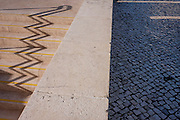 An urban landscape zigzag of shadows from the steps and handrails of Alameda Metro station, on 14th July 2016, in Lisbon, Portugal. One the sunny side are the distorted lines  of the well-trodden stairs at this main transport merge of underground train lines - and the blue tiles that act as cobbles, seen on all Portuguese streets. (Photo by Richard Baker / In Pictures via Getty Images)