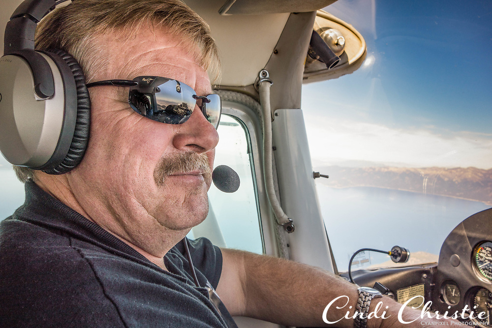 Tyrell Kremer pilots his Cessna 182 above the Sierra Nevada en route from Stockton, Calif., to Salmon, Idaho, on Oct. 8, 2016. He was reported missing on Oct. 15 as he attempted to fly to Jackson, Calif. Following an air and ground search that was delayed by poor weather conditions, he was  found near the wreckage of his plane in a rugged and remote of the Sierra near Lake Schmidell on Oct. 18 (© 2016 Cindi Christie)  Permission is granted to the Sacramento Bee to publish in print and online. Mags out. No distribution. No archive.