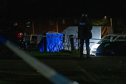 © Licensed to London News Pictures. 07/02/2021. Reading, UK. A blue forensic tent sits next to a white van. At approximately 18:55GMT on Saturday 06/02/2021 Thames Valley Police were called to reports of an altercation in Dulnan Close, Tilehurst in Reading. A 25-year-old man sustained multiple injuries and died at the scene. Photo credit: Peter Manning/LNP