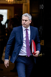 © Licensed to London News Pictures. 12/03/2019. London, UK. Secretary of State for Exiting the European Union Stephen Barclay leaves 10 Downing Street after the Cabinet meeting. MPs will get a second meaningful vote on Prime Minister Theresa May's Brexit deal this evening. Photo credit: Rob Pinney/LNP