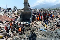 Oct. 3, 2018 - Palu, Indonesia - Search and Rescue team members search for victims at Balaroa, in Palu, Central Sulawesi, Indonesia. The death toll from Indonesia's multiple earthquakes and an ensuing tsunami jumped to 1,407 on Wednesday, the country's disaster management agency said.   (Credit Image: © Agung Kuncahya B/Xinhua via ZUMA Wire)