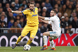 (l-r) Gonzalo Higuain of Juventus FC, Daniel Carvajal of Real Madrid during the UEFA Champions League quarter final match between Real Madrid and Juventus FC at the Santiago Bernabeu stadium on April 11, 2018 in Madrid, Spain