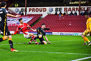 Kieffer Moore of Barnsley (19) scores a goal to make the score 2-0 during the EFL Sky Bet League 1 match between Barnsley and Bradford City at Oakwell, Barnsley, England on 12 January 2019.